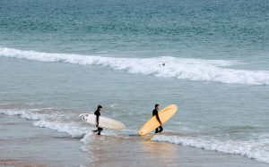 The surfer, the surfboard, the teacher and the wave